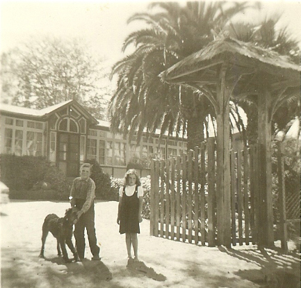 Susan, Michael and Jimmy the Airedale, in front of the Casa Patronal.