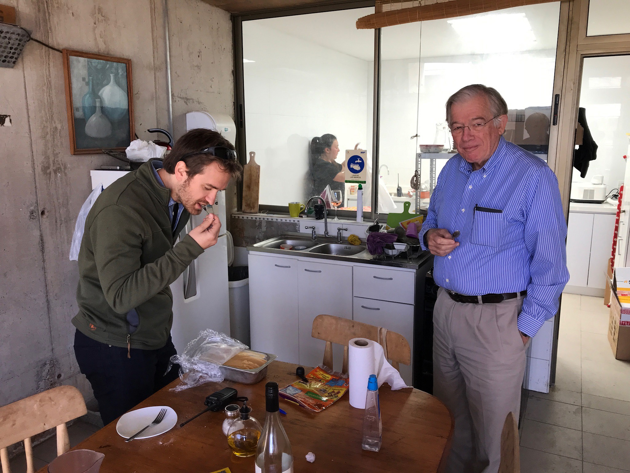 Amael and my Dad, Michael Kingston, sample homemade salted caramel ice cream in the staff kitchen.
