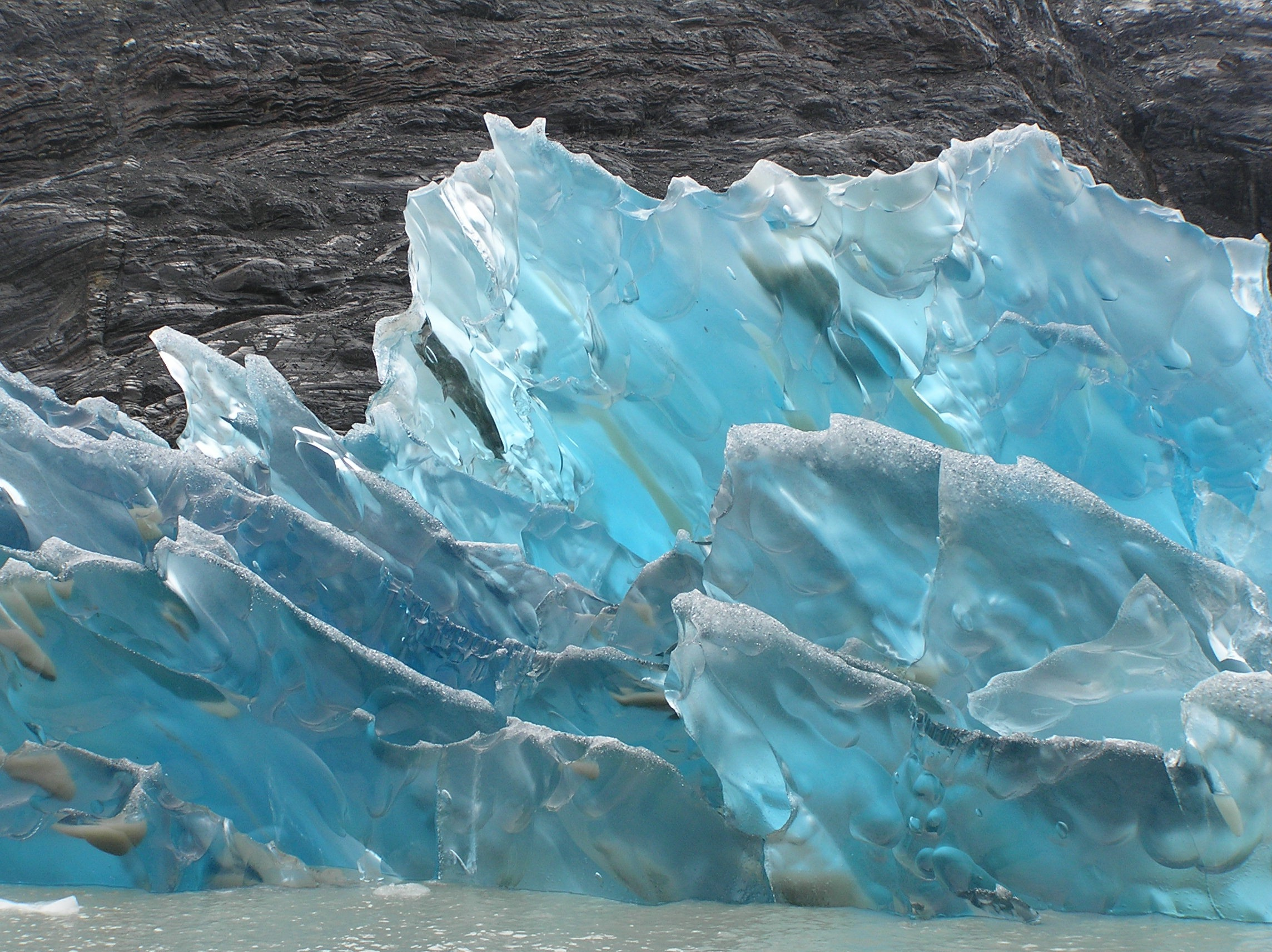 The icy edges of an aquamarine glacier. <em>Photo Credit: Luis