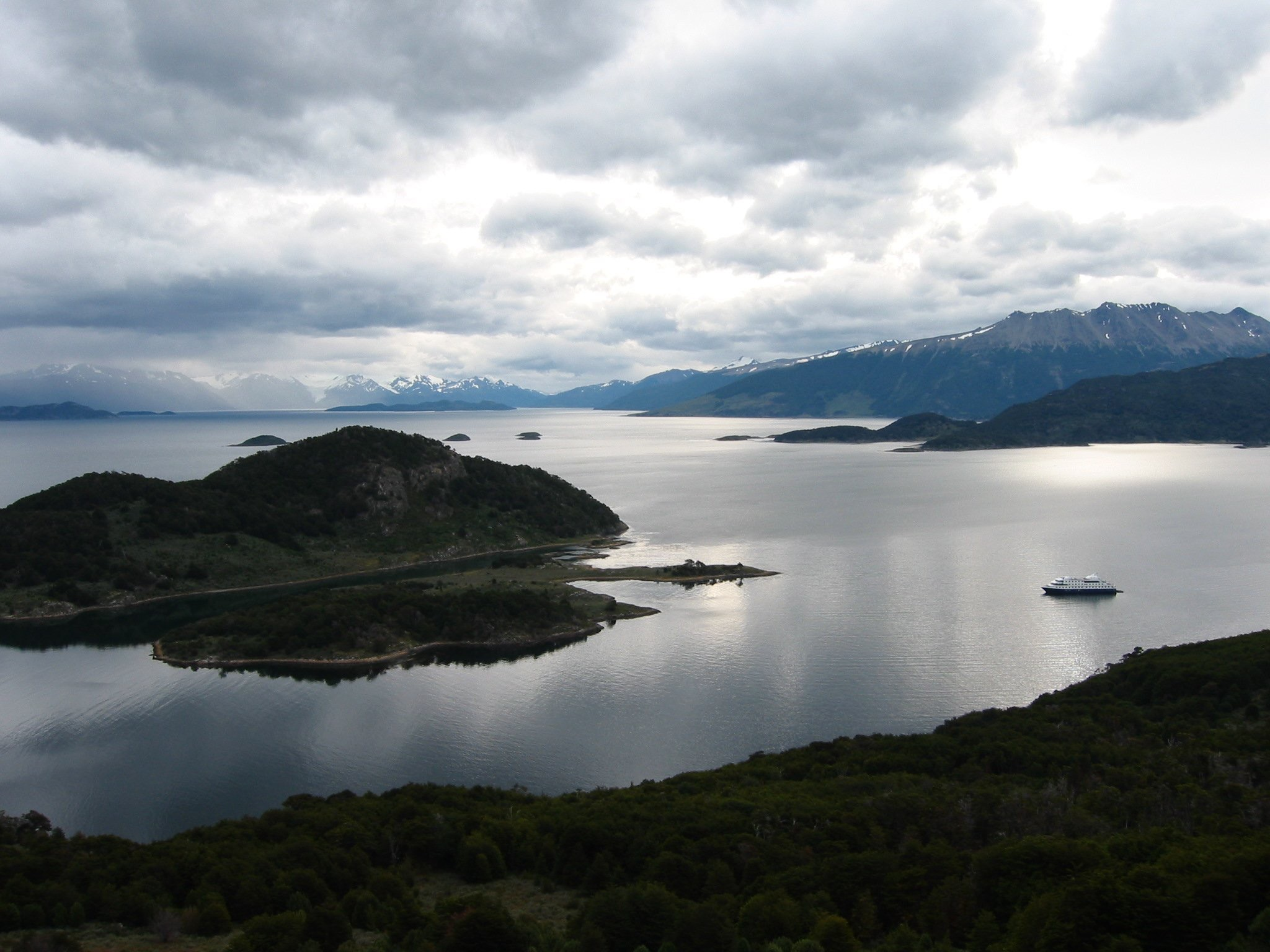 An Australis ship floats among Patagonia's fjords.