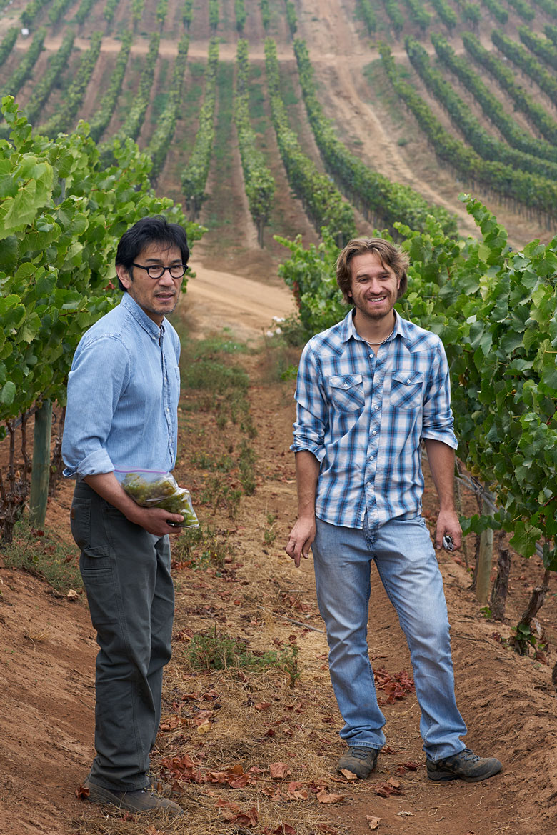 Amael Orrego, in the vineyards with our Californian winemaker, Byron Kosuge, left.