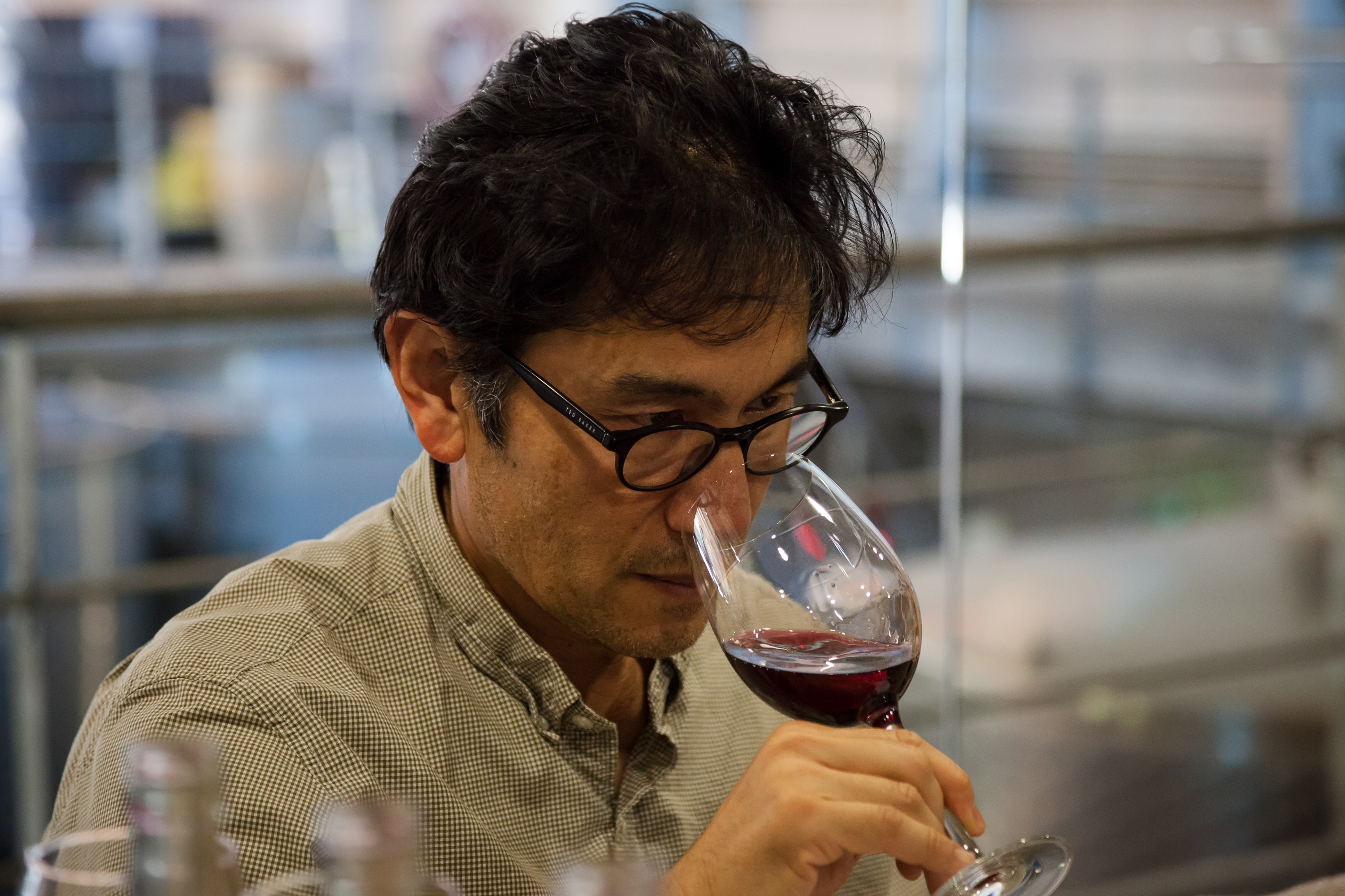 Byron searches for inner peace in the glass. Actually, he's tasting our Pinot Noir to decide the final blend for Alazan.