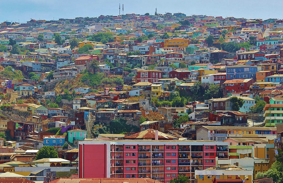 Brightly painted buildings dot the city's steep hillsides.