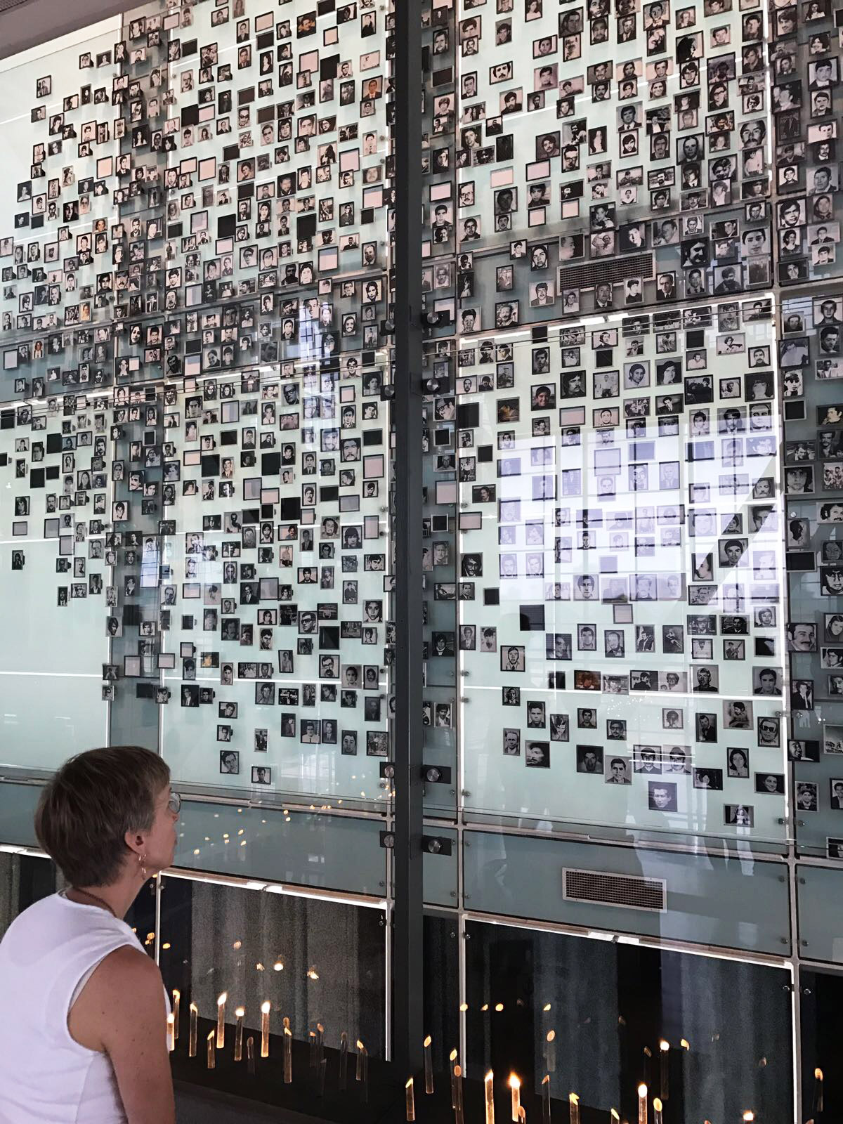 "A photo wall of ""the disappeared"" at the Museo de la Memoria y los Derechos Humanos."