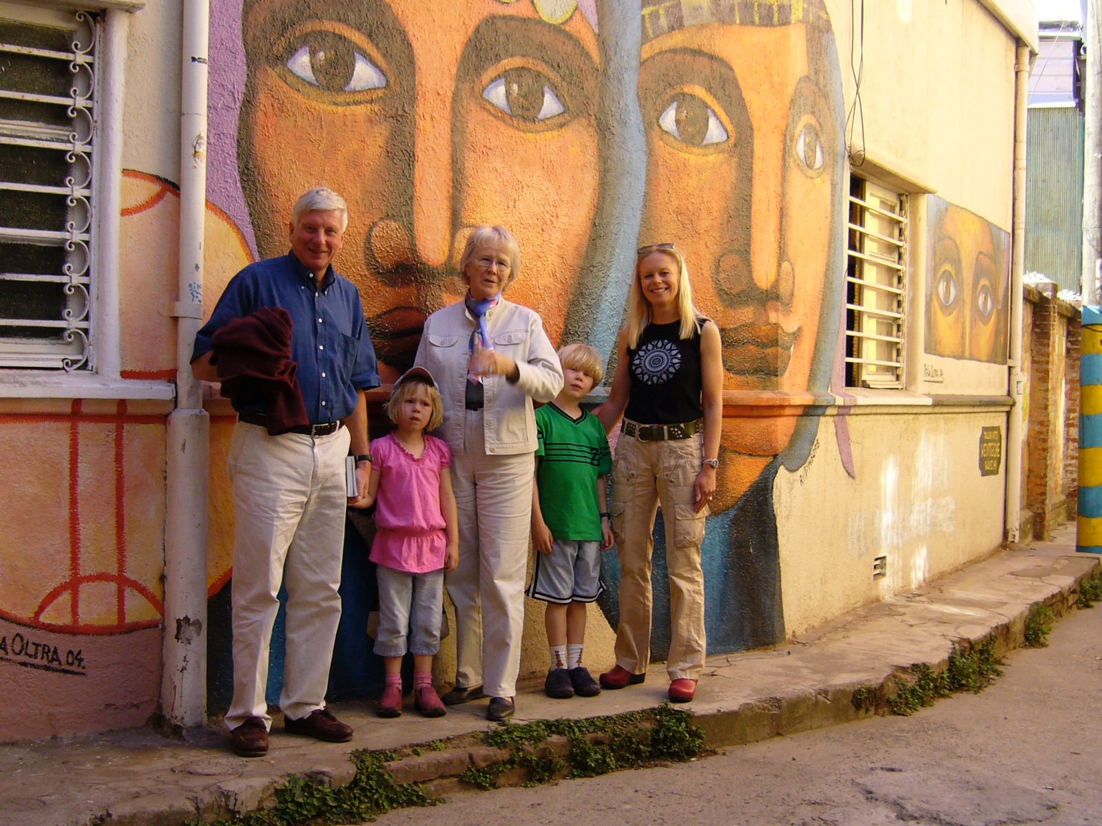 A family photo in front of one of the city's many murals.