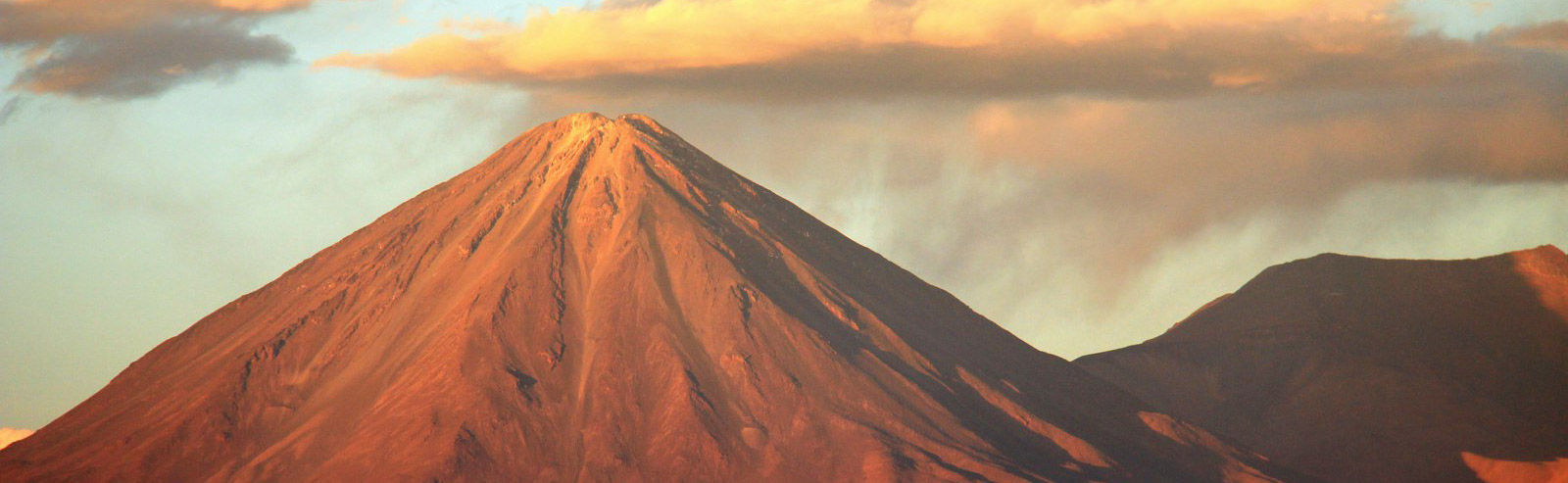 Volcán Licancabur towers over the Atacama Desert. Photo credit Krheesy, Flickr.