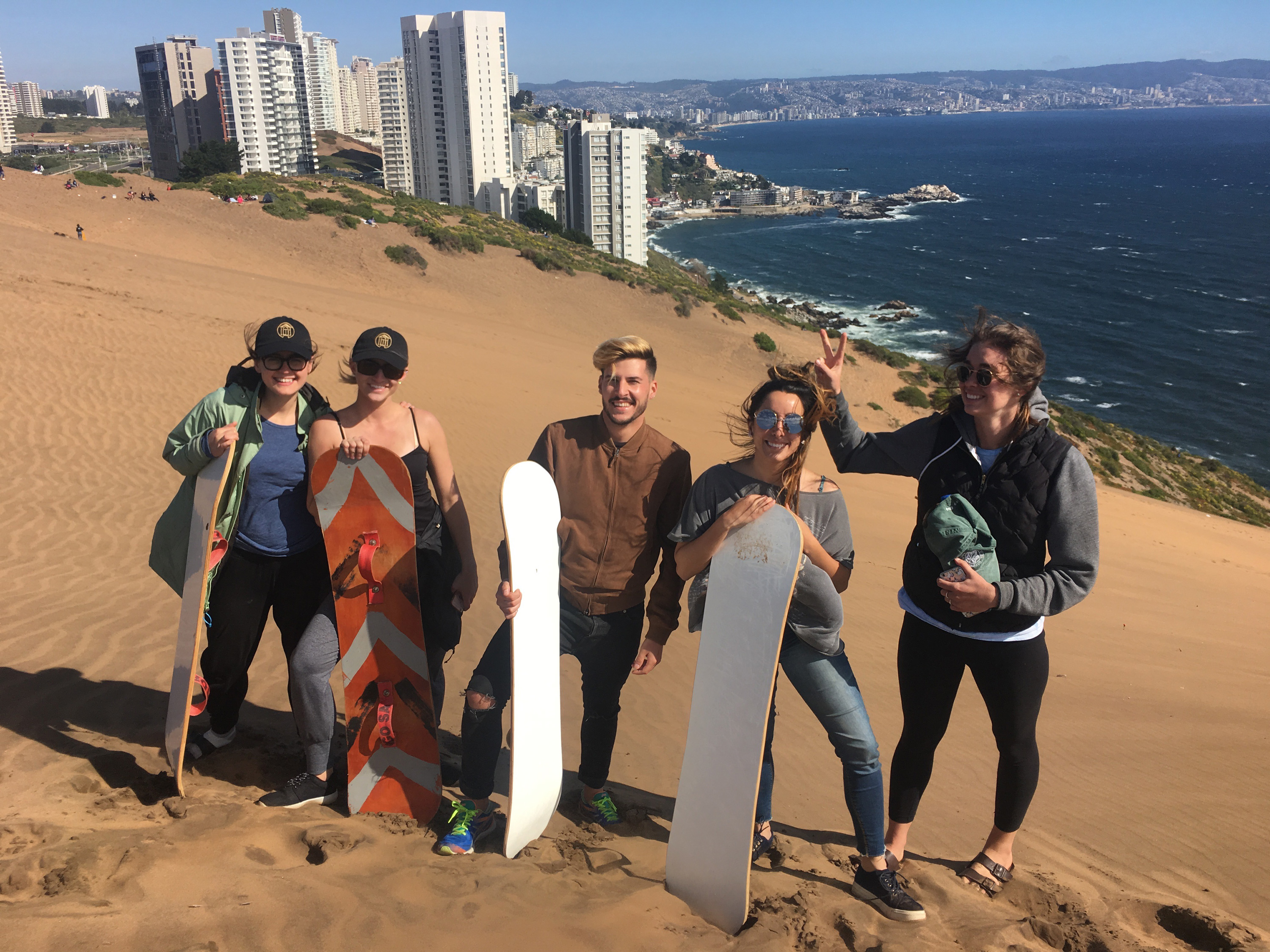 Fellows exploring the sand dunes around Viña del Mar, with mentor Constanza and California office colleague, Patrick.