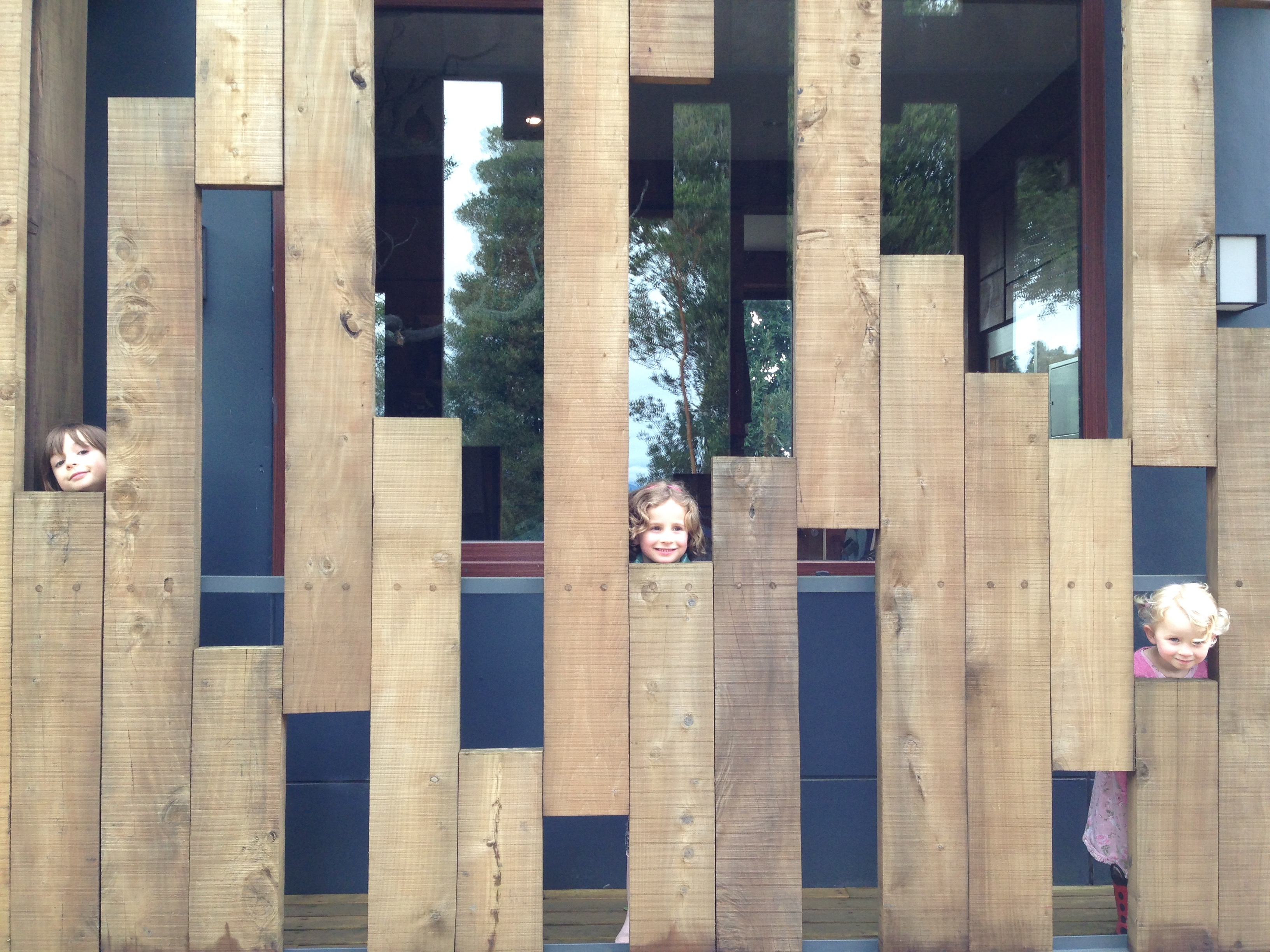 Our kids peek through decorative wooden slats at Cantarias Lodge and Spa.